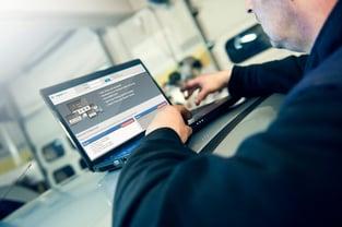 Mechanic working on computer_RL.jpg