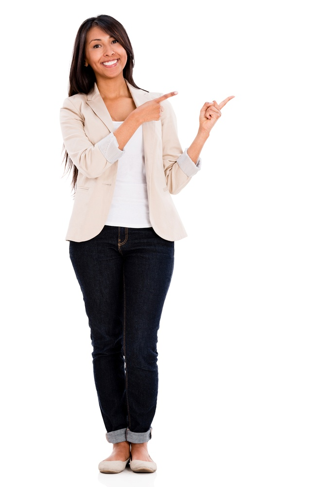 Casual woman pointing to the side - isolated over a white background.jpeg